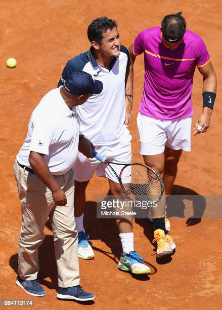 Nicolas Almagro of Spain is helped off court by Rafael Nadal of Spain and umpire Carlos Bernardes after retiring at 03 in the opening set on Day Four...