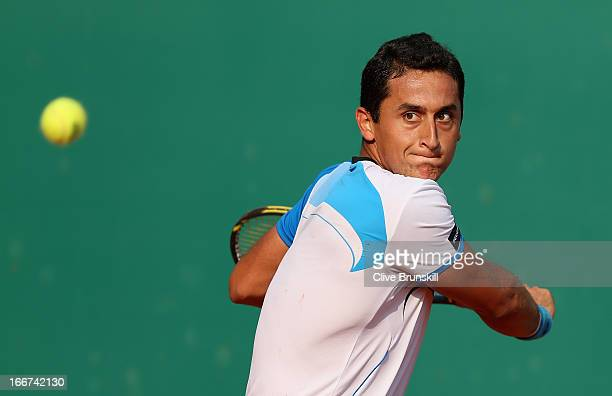 Nicolas Almagro of Spain lines up a backhand against David Goffin of Belgium in their first round match during day three of the ATP Monte Carlo...