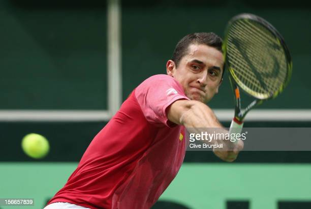 Nicolas Almagro of Spain plays a backhand against Radek Stepanek of Czech Republic during day three of the final Davis Cup match between Czech...