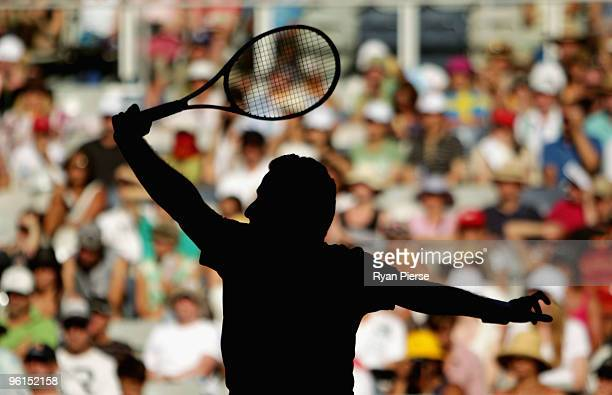 Nicolas Almagro of Spain plays a backhand in his fourth round match against JoWilfried Tsonga of France during day eight of the 2010 Australian Open...