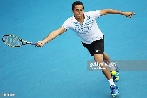 Nicolas Almagro of Spain plays a forehand against Philipp Kohlschreiber of Germany during day four of the 2012 Heineken Open at ASB Tennis Centre on...