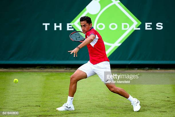 Nicolas Almagro of Spain plays a forehand during his match against Janko Tipsarevic of Serbia during day one of The Boodles Tennis Event at Stoke...