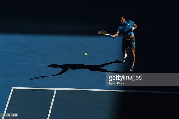 Nicolas Almagro of Spain plays a forehand in his fourth round match against JoWilfried Tsonga of France during day eight of the 2010 Australian Open...