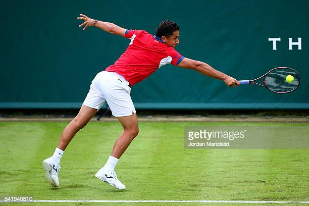 Nicolas Almagro of Spain reaches for a backhand during his match against Janko Tipsarevic of Serbia during day one of The Boodles Tennis Event at...