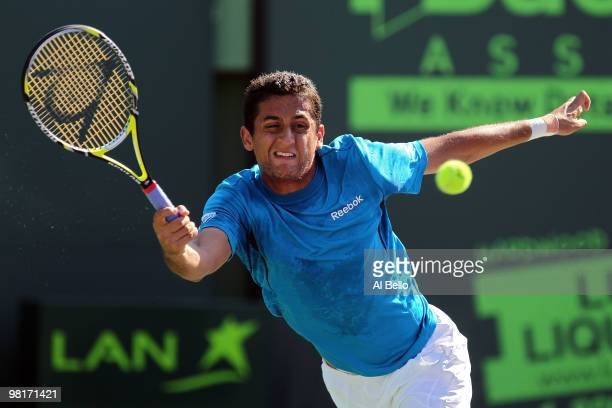 Nicolas Almagro of Spain returns a shot against Andy Roddick of the United States during day nine of the 2010 Sony Ericsson Open at Crandon Park...