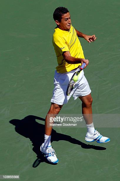 Nicolas Almagro of Spain returns a shot against Sam Querrey of the United States during his men's singles match on day seven of the 2010 US Open at...