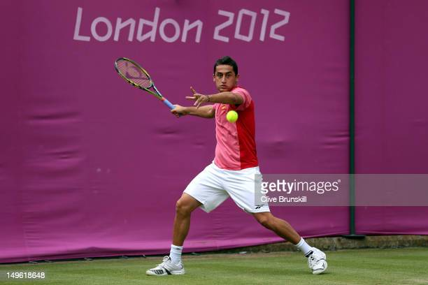 Nicolas Almagro of Spain returns a shot to Steve Darcis of Belgium during the third round of Men's Singles Tennis on Day 5 of the London 2012 Olympic...