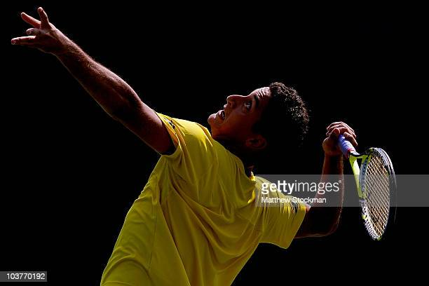Nicolas Almagro of Spain serves against Potito Starace of Italy during his first round men's singles match on day three of the 2010 US Open at the...