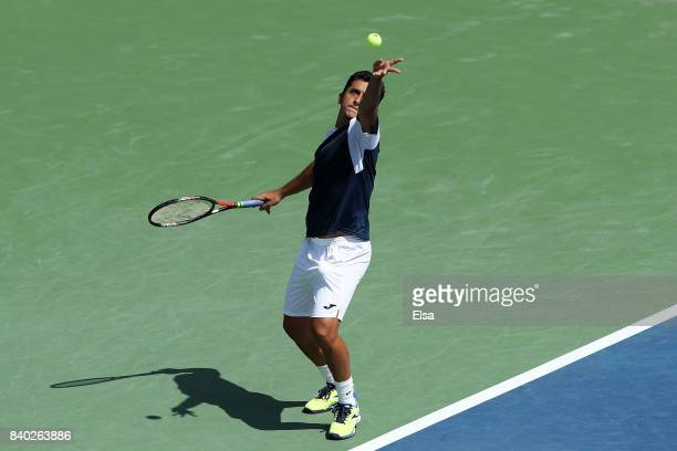Nicolas Almagro of Spain serves during his first round Men's Singles match against Steve Johnson of the United States on Day One of the 2017 US Open...