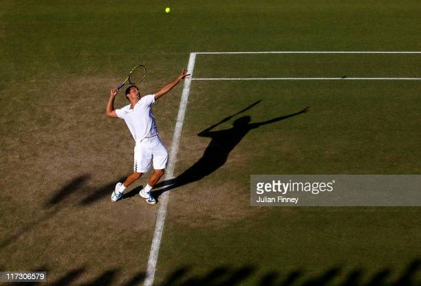 Nicolas Almagro of Spain serves during his third round match against Mikhail Youzhny of Russia on Day Six of the Wimbledon Lawn Tennis Championships...
