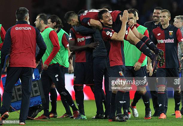 Nicolas Andres Burdisso and Giovanni Simeone of Genoa CFC celebrate a victory at the end of the Serie A match between Genoa CFC and Juventus FC at...