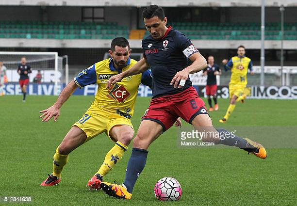Nicolas Andres Burdisso of Genoa CFC competes for the ball with Sergio Pellissier of AC Chievo Verona during the Serie A match between AC Chievo...