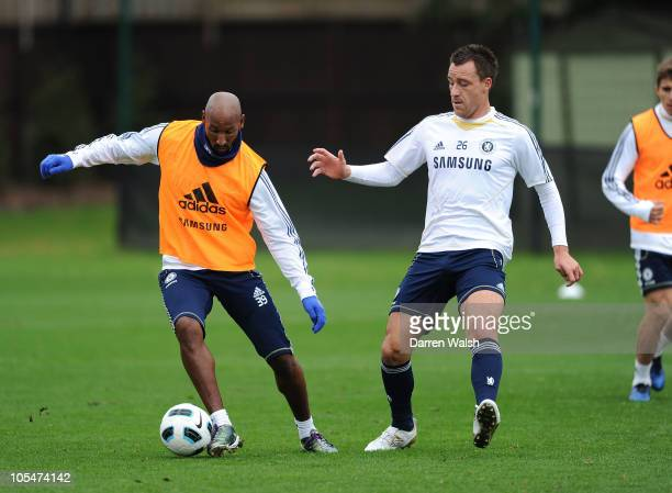 Nicolas Anelka and John Terry of Chelsea during a training session at the Cobham Training ground on October 15 2010 in Cobham England