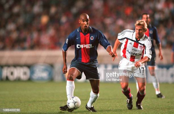 Nicolas ANELKA and Torsten FINK during the champions league match between Paris Saint Germain and Bayern Munich on september 26 2000 in Paris France