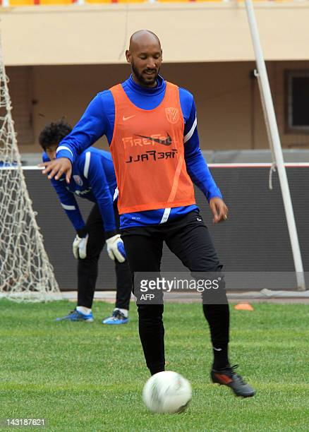 Nicolas Anelka newly named playercoach for Shanghai Shenhua trains with his team in Dalian northeast China's Liaoning province on April 20 prior to...