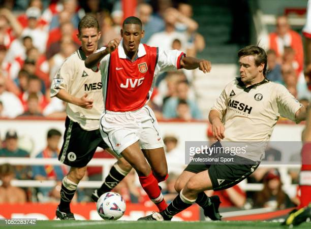 Nicolas Anelka of Arsenal is challenged by Steve Brown of Charlton Athletic during an FA Carling Premiership match at Highbury on August 29 1998 in...