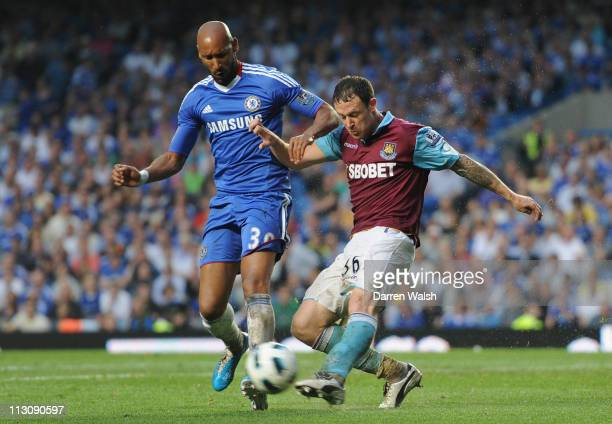 Nicolas Anelka of Chelsea and Wayne Bridge of West Ham United battle for the ball during the Barclays Premier League match between Chelsea and West...