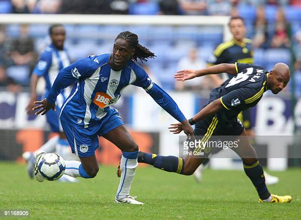 Nicolas Anelka of Chelsea cannot stop Mario Melchiot of Wigan Athletic during the Barclays Premier League match between Wigan Athletic and Chelseaat...