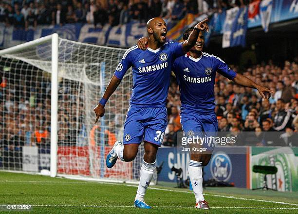 Nicolas Anelka of Chelsea celebrates his goal from the penalty spot with team-mate Florent Malouda during the UEFA Champions League Group F match...