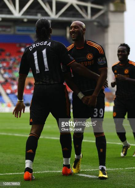 Nicolas Anelka of Chelsea celebrates with Didier Drogba as he scores their third goal during the Barclays Premier League match between Wigan Athletic...