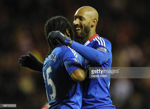 Nicolas Anelka of Chelsea celebrates with team mate Florent Malouda after he scores his team's fourth goal during the Barclays Premier League match...