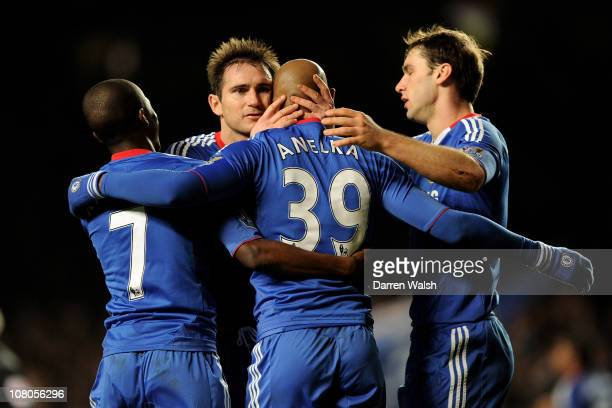 Nicolas Anelka of Chelsea celebrates with teammates after scoring their second goal during the Barclays Premier League match between Chelsea and...