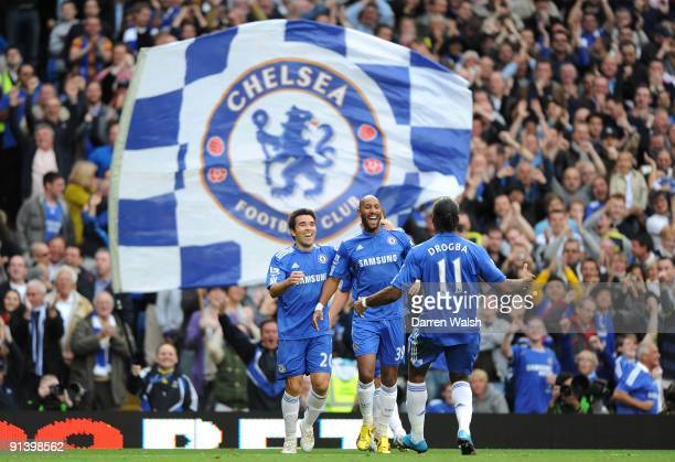 Nicolas Anelka of Chelsea celebrates with teammates Deco and Didier Drogba after scoring the opening goal during the Barclays Premier League match...