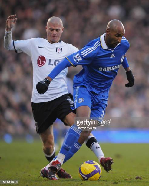 Nicolas Anelka of Chelsea is challenged by Paul Konchesky of Fulham during the Barclays Premier League match between Fulham and Chelsea at Craven...