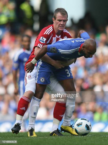 Nicolas Anelka of Chelsea is held by Glenn Whelan of Stoke City during the Barclays Premier League match between Chelsea and Stoke City at Stamford...