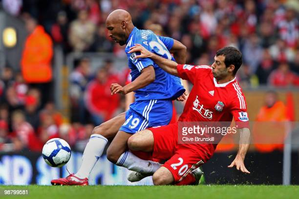 Nicolas Anelka of Chelsea is tackled by Javier Mascherano of Liverpool during the Barclays Premier League match between Liverpool and Chelsea at...