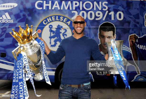 Nicolas Anelka of Chelsea poses with the Premier League and FA Cup trophies prior to the Chelsea Football Club Victory Parade on May 16, 2010 in...