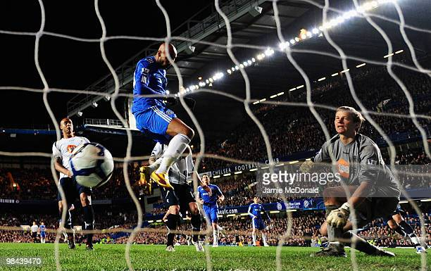 Nicolas Anelka of Chelsea scores their first goal with a header to beat Jussi Jaaskelainen of Bolton Wanderers during the Barclays Premier League...