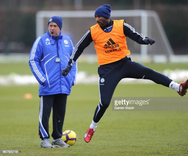 Nicolas Anelka of Chelsea shoots at goal and watched by Chelsea manager Carlo Ancelotti during a training session at the Cobham training ground on...