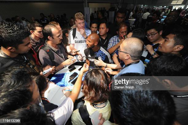Nicolas Anelka of Chelsea talks to the media during Chelsea's Blue Pitches event which aims to strengthen ties with local communities promoting...