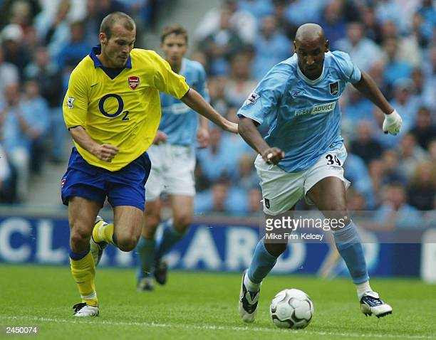 Nicolas Anelka of Man City clashes with Fredrik Ljungberg of Arsenal during the FA Barclaycard Premiership match between Manchester City and Arsenal...