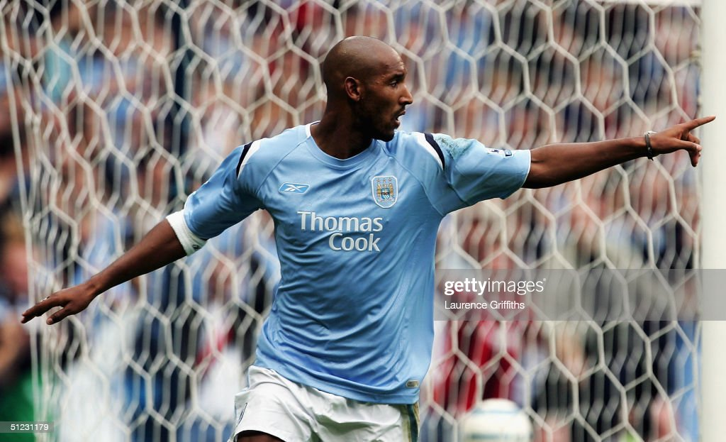 https://media.gettyimages.com/photos/nicolas-anelka-of-manchester-city-celebrates-his-2nd-goal-during-the-picture-id51231179