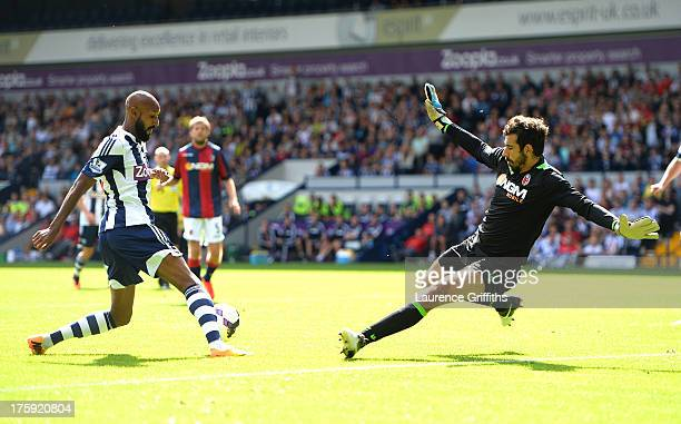 Nicolas Anelka of West Bormwich Albion scores the second goal past Gianluca Curci of Bologna during a Pre Season Friendly between West Bromwich...
