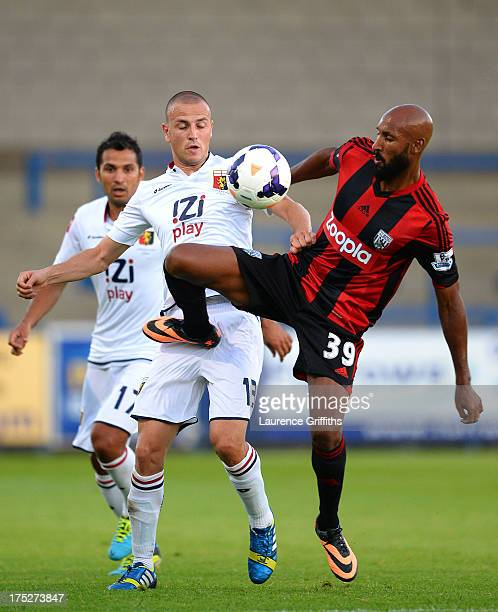 Nicolas Anelka of West Bromwich Albion battles with Antonelli Luca of Genoa during a Pre Season Friendly between West Bromwich Albion and Genoa at...