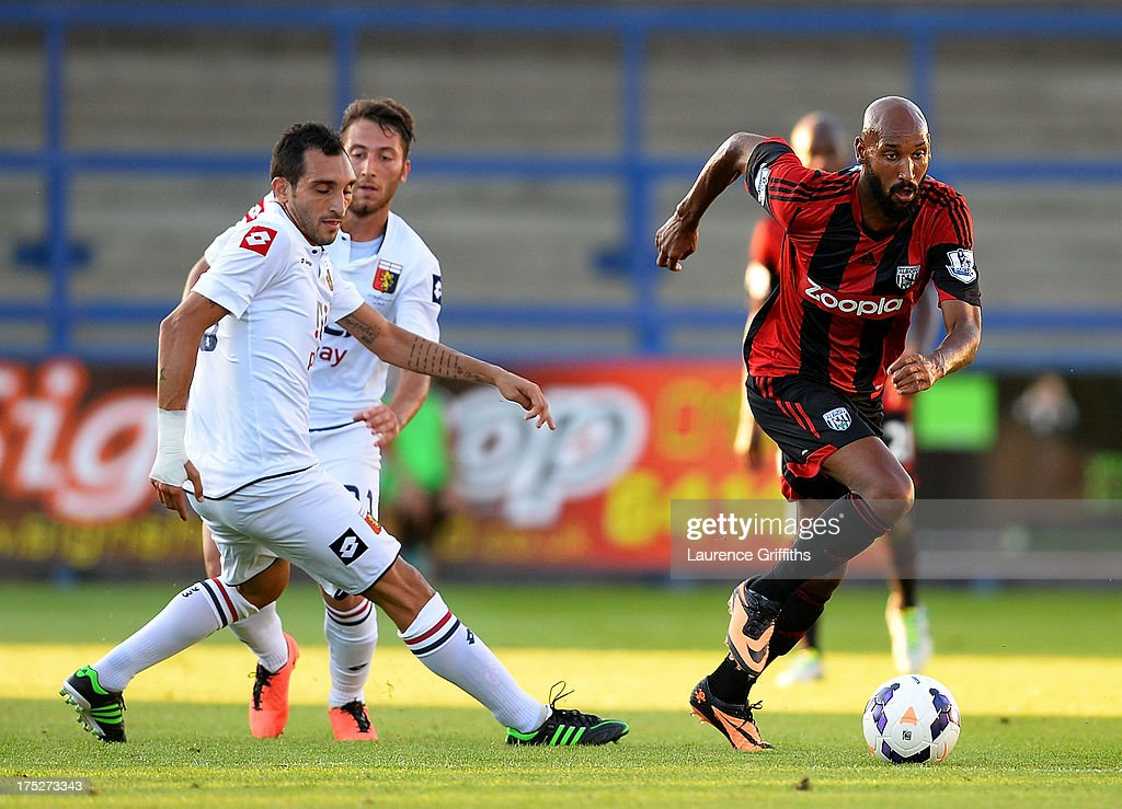 Nicolas Anelka of West Bromwich Albion battles with Lodi Francesco of Genoa during a Pre Season Friendly between West Bromwich Albion and Genoa at the New Bucks Head Stadium on August 1, 2013 in Telford, England.