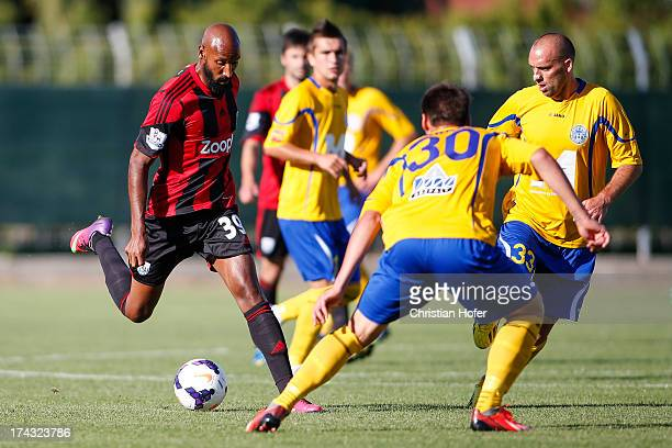 Nicolas Anelka of West Bromwich Albion challenges Norbert Farkas and Balazs Toth of Puskas FC Academy during the pre season friendly match between...