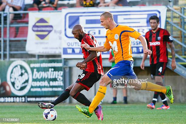 Nicolas Anelka of West Bromwich challenges Gergoe Vaszicsky of Puskas FC Academy during the pre season friendly match between Puskas FC Academy and...