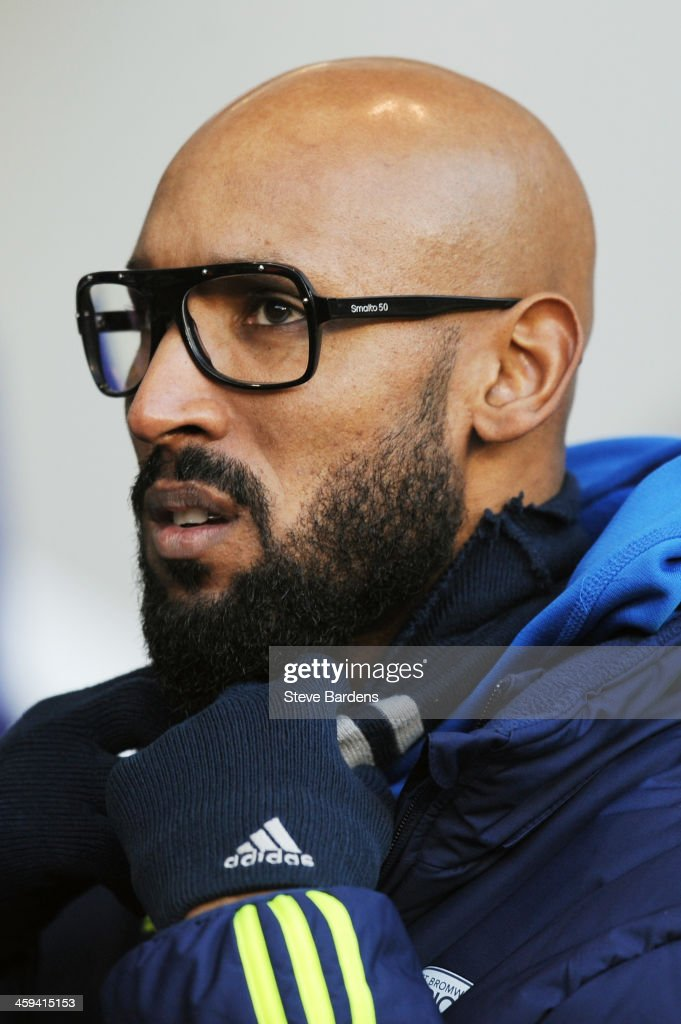Nicolas Anelka of West Bromwich looks on from the sidelines during the Barclays Premier League match between Tottenham Hotspur and West Bromwich Albion on December 26 2013 in London, England.