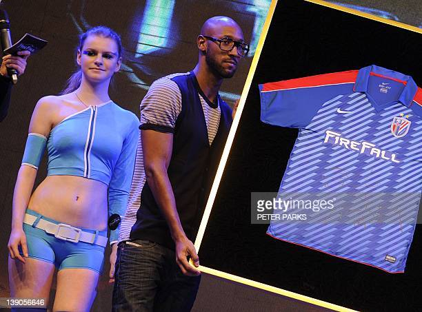 Nicolas Anelka the most highprofile foreign footballer ever to sign for the Chinese league holds up a jersey he signed at a sponsors event in...