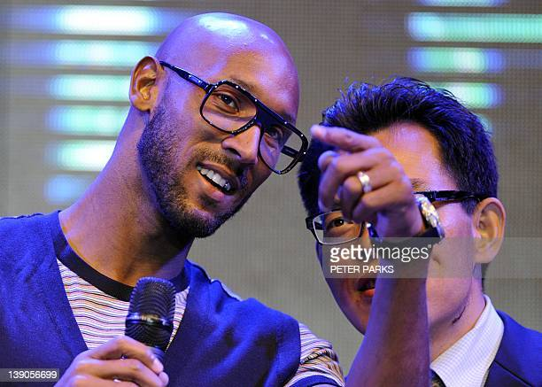Nicolas Anelka the most highprofile foreign footballer ever to sign for the Chinese league talks to his translator at a sponsors event in Shanghai on...