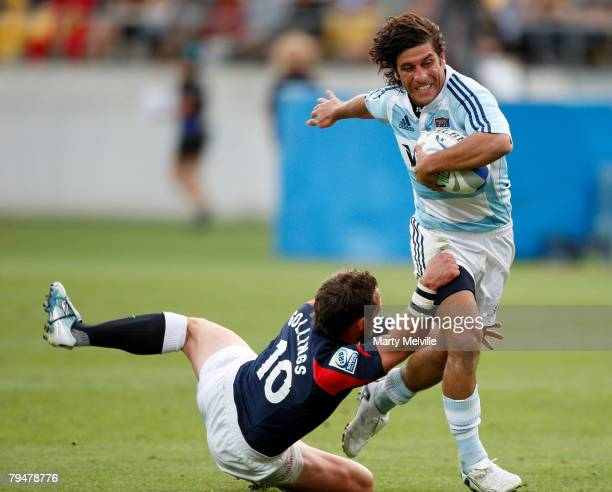 Nicolas Areil Bruzzone of Argentina gets tackled by Ben Gollings of England during a Bowl Final match between England and Argentina during the New...