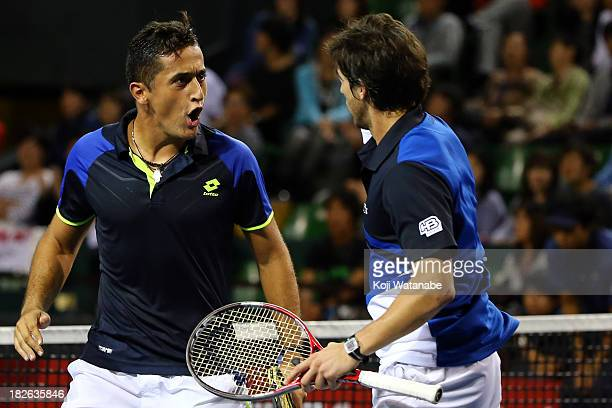 Nicolas Armagro of Spain and Pablo Cuevas of Uruguay react during the men's first round doubles match against Bob Bryan of the United States and Mike...