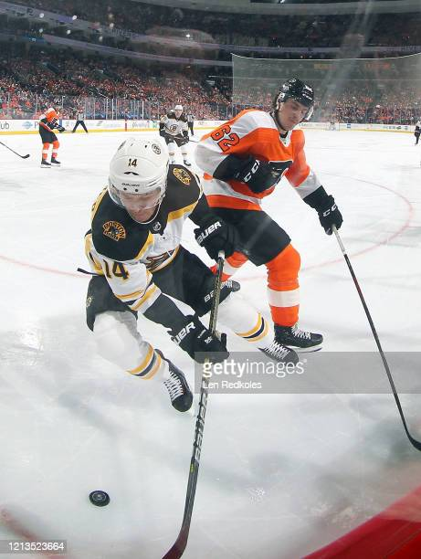 Nicolas AubeKubel of the Philadelphia Flyers battles for the puck in the corner against Chris Wagner of the Boston Bruins on March 10 2020 at the...