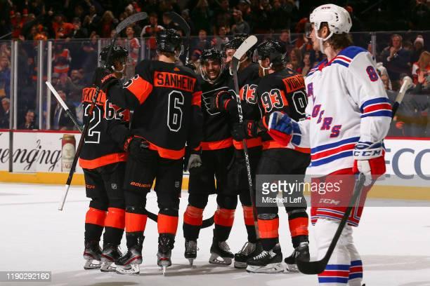 Nicolas Aube-Kubel of the Philadelphia Flyers celebrates his first career NHL goal with Travis Sanheim, Shayne Gostisbehere, Kevin Hayes, and Jakub...