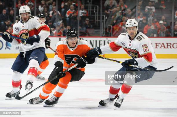 Nicolas Aube-Kubel of the Philadelphia Flyers skates against Juho Lammikko and Troy Brouwer of the Florida Panthers on November 13, 2018 at the Wells...