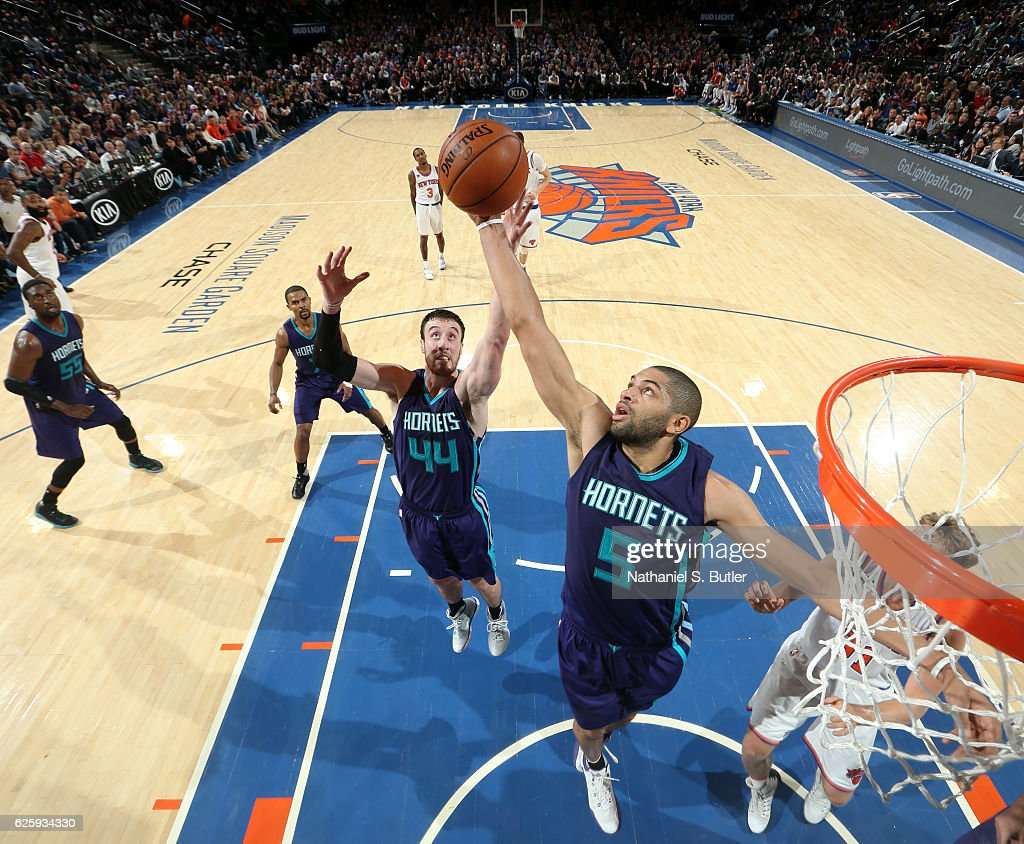Nicolas Batum #5 and Frank Kaminsky III #44 of the Charlotte Hornets go up for a rebound against the New York Knicks at Madison Square Garden in New York, New York.